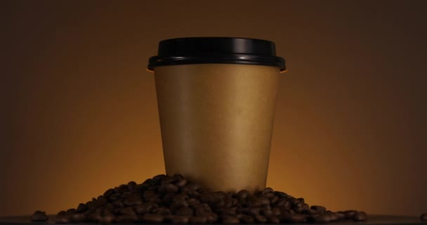 Brown paper coffee cup spinning. Disposable cup for hot drinks. Coffee beans. Espresso, latte, cappuccino for take away