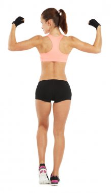 Whole length image of young sporty woman showing her biceps isol
