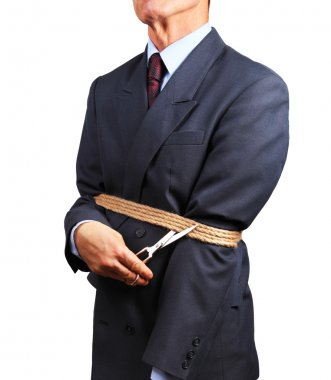 Image of businessman trying to get rid of fetters