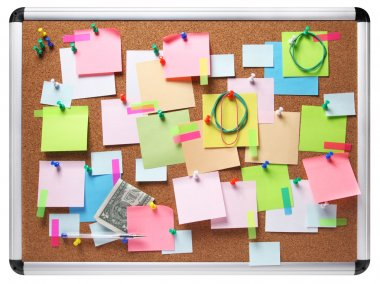 Isolated image of colorful sticky notes on cork bulletin board