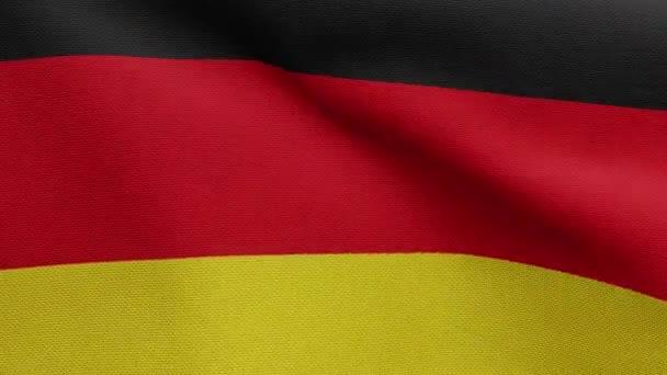Die deutsche Fahne weht im Wind. Großaufnahme von Deutschland-Fahne weht, weiche und glatte Seide. Textur Stoff Fähnrich Hintergrund. Nutzen Sie es für nationale Feiertage und Länderanlässe.