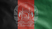 Afghan flag waving in the wind. Close up of Afghanistan banner blowing, soft and smooth silk. Cloth fabric texture ensign background. Use it for national day and country occasions concept.