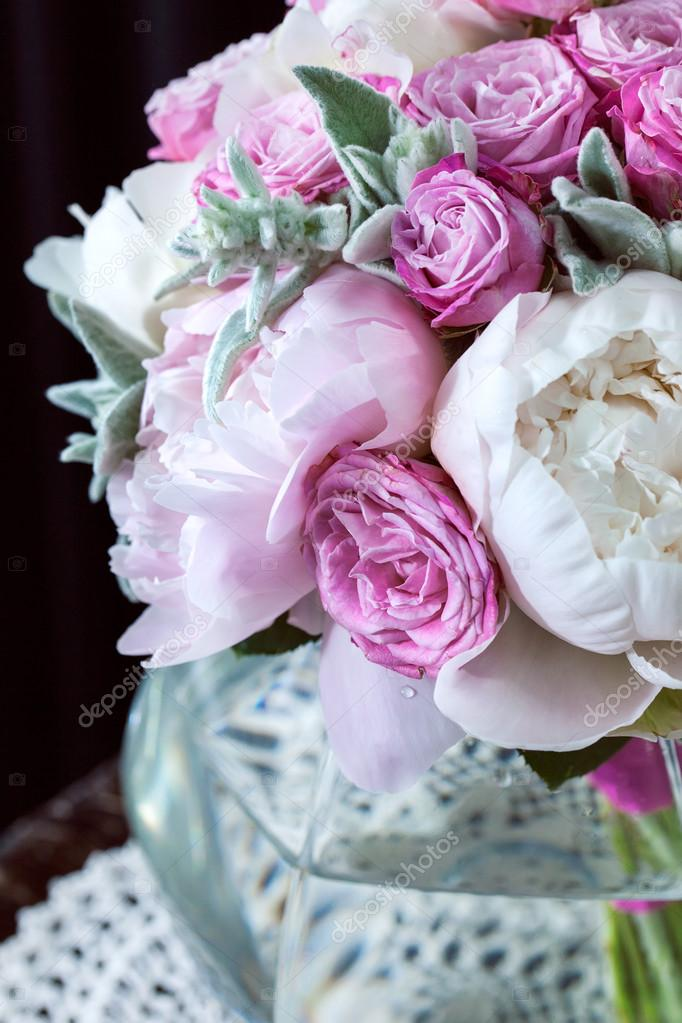 a bouquet of roses peonies