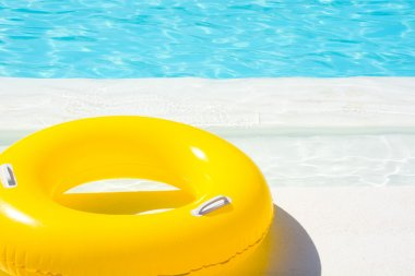 Yellow pool float in blue swimming pool