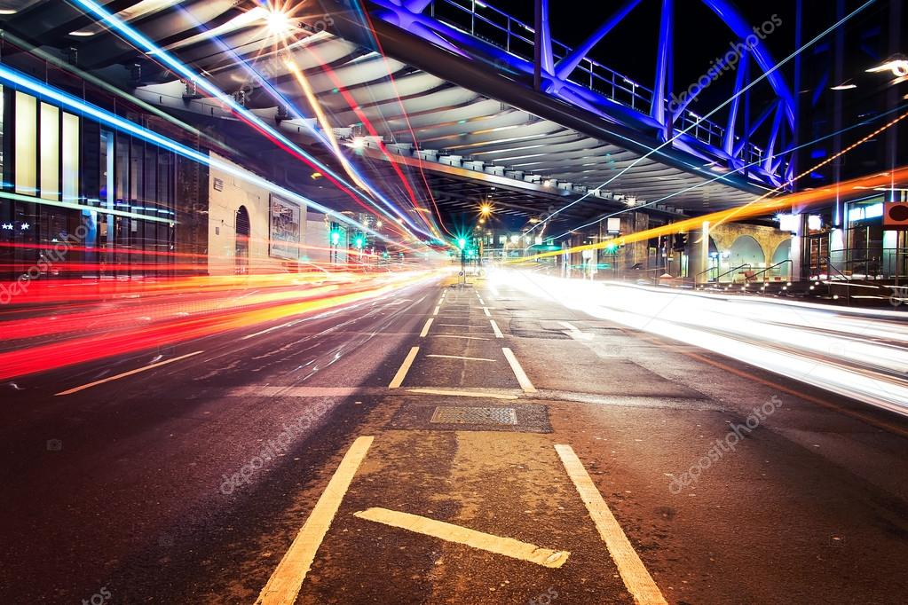 Light trails in City of London with bridge