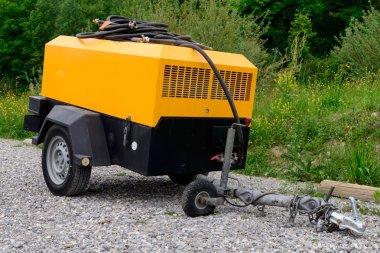 a yellow compressor site