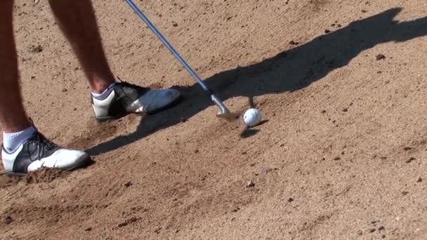 Golf ball hit out of bunker