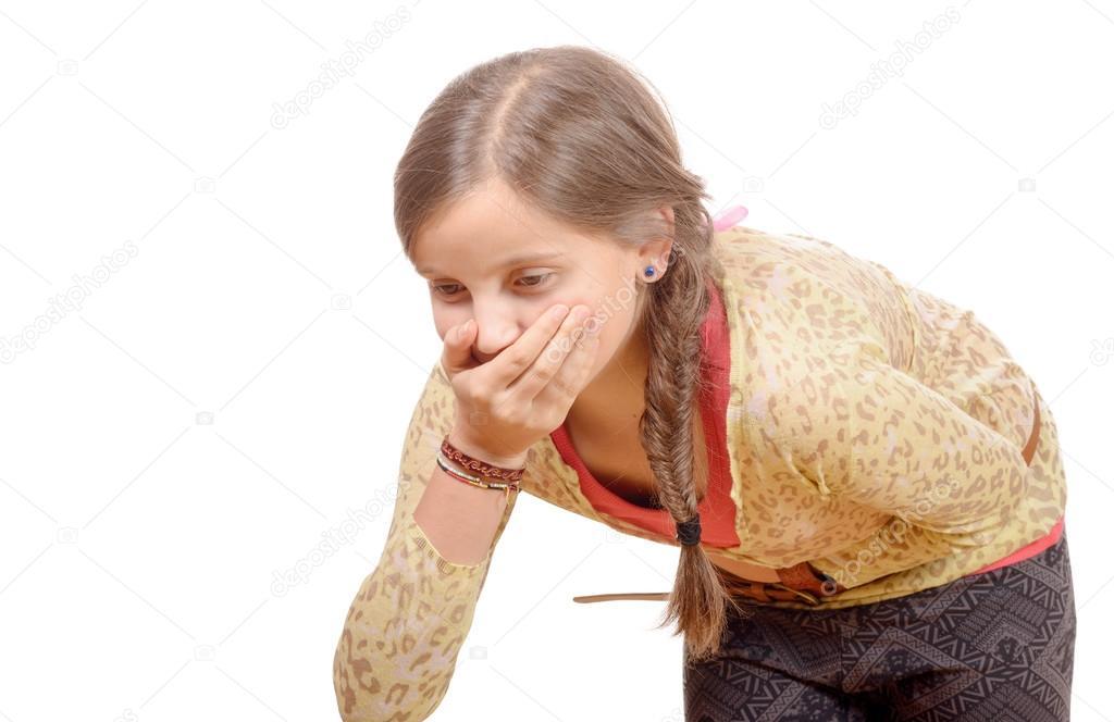 a little girl  has a stomachache