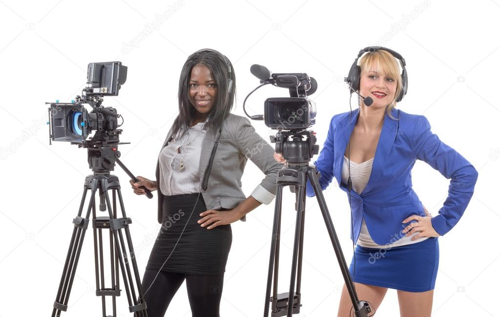 Two beautiful young women with a professional video camera — Stock Photo f8cfb9e530