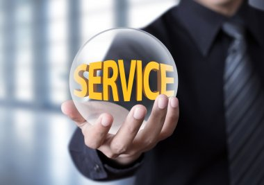 Businessman holding crystal ball with service concept