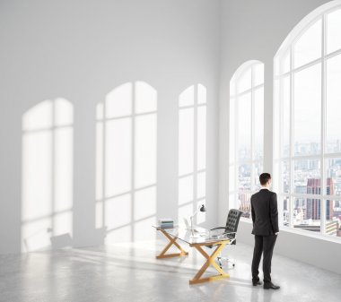 Businessman looks out windows
