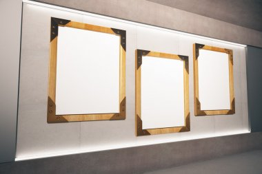 Blank wooden picture frames on beige wall in empty room, mock up