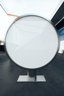 Round billboard stand in interior. Mock up, 3D Rendering