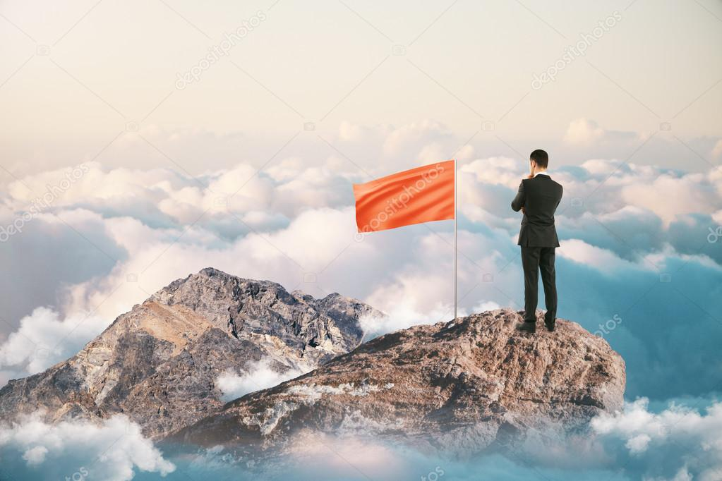 Successful leader on mountain top