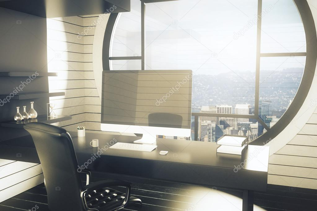 Kantoor werkplek met donkere stoel bureau met lege computer