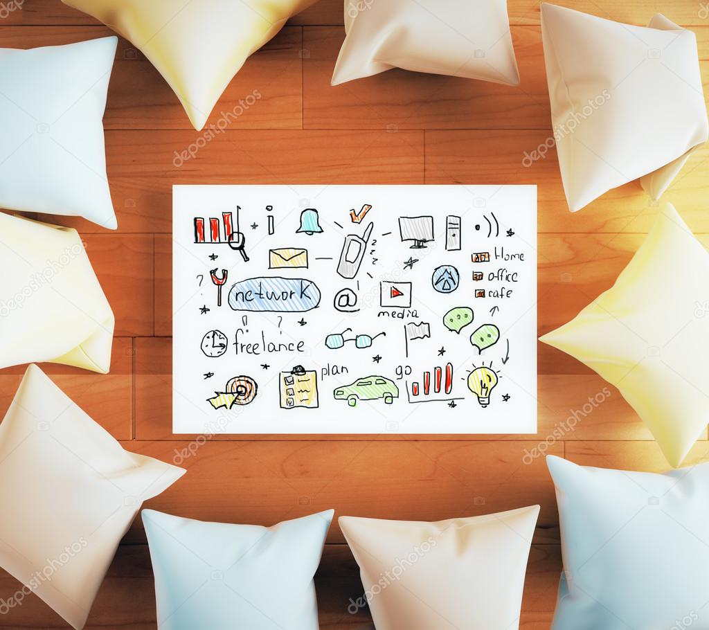 Pillows around business sketch