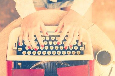 Girl typing on typewriter