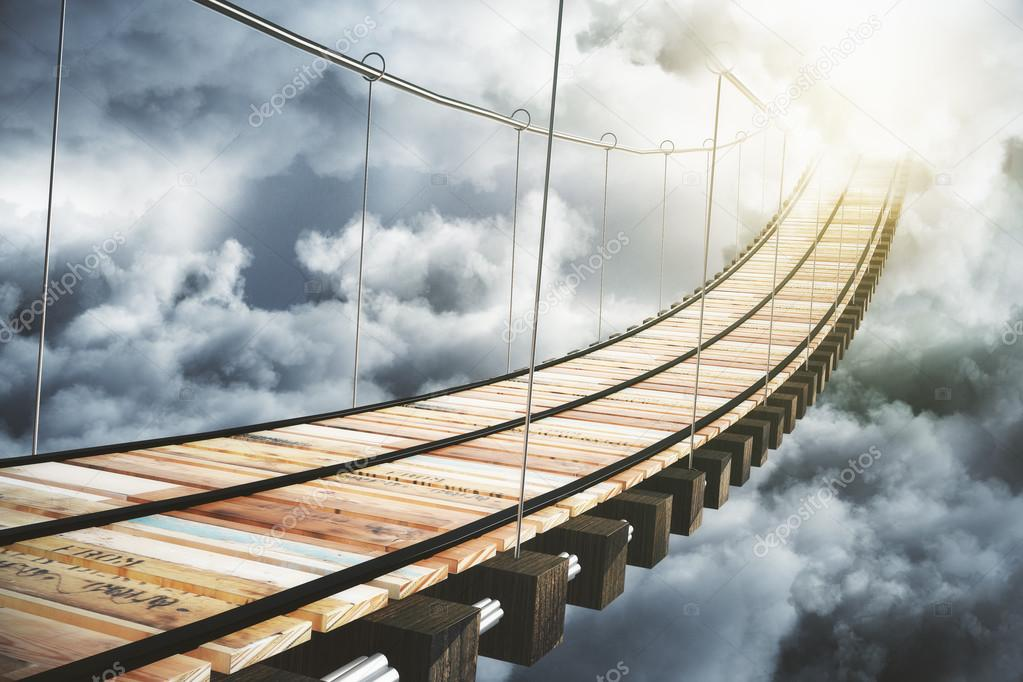 Wooden bridge in the clouds