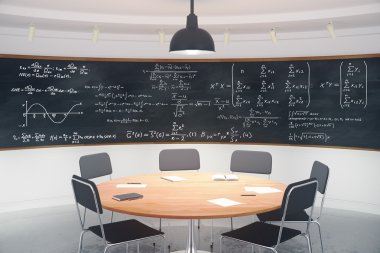 Modern classroom with blackboard with equations and furniture
