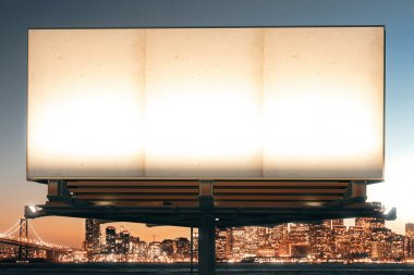 Mock up of blank billboard on the background of the city at nigh
