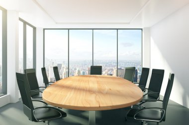 Sunny conference room with oval table, chairs and city view