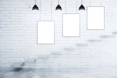 Blank picture frames on white brick wall, lamps and stairs, mock