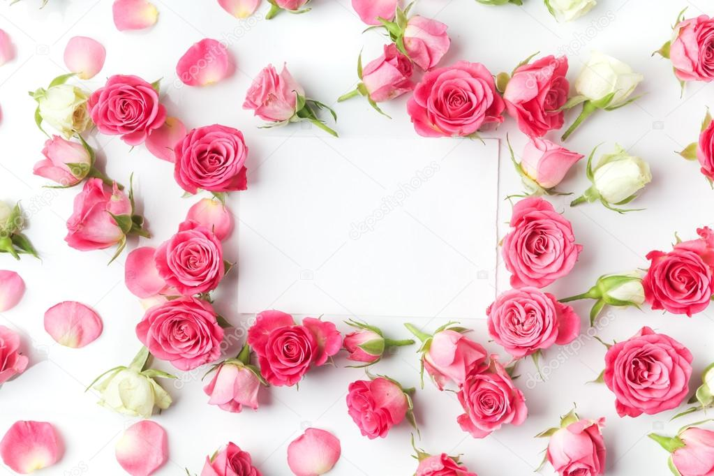 Framework from roses on white background. Flat lay. Top view