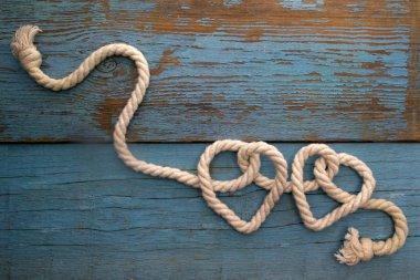leash  rope into heart shape on wood