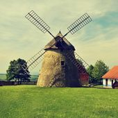 Photo Old windmill - Czech Republic Europe. Beautiful old traditional mill house with a garden. Kuzelov - South Moravia.