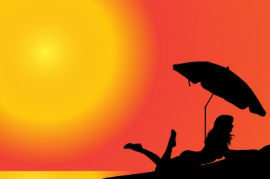 Silhouette of a woman who is sunbathing