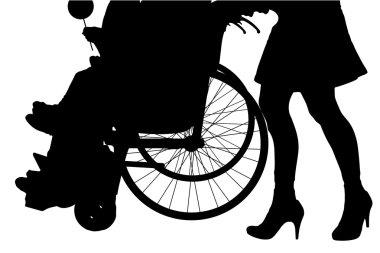female legs and man in wheelchair