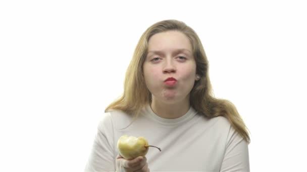 Fatty woman eating pear, third video