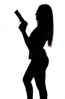 Silhouette of young sexy woman with gun