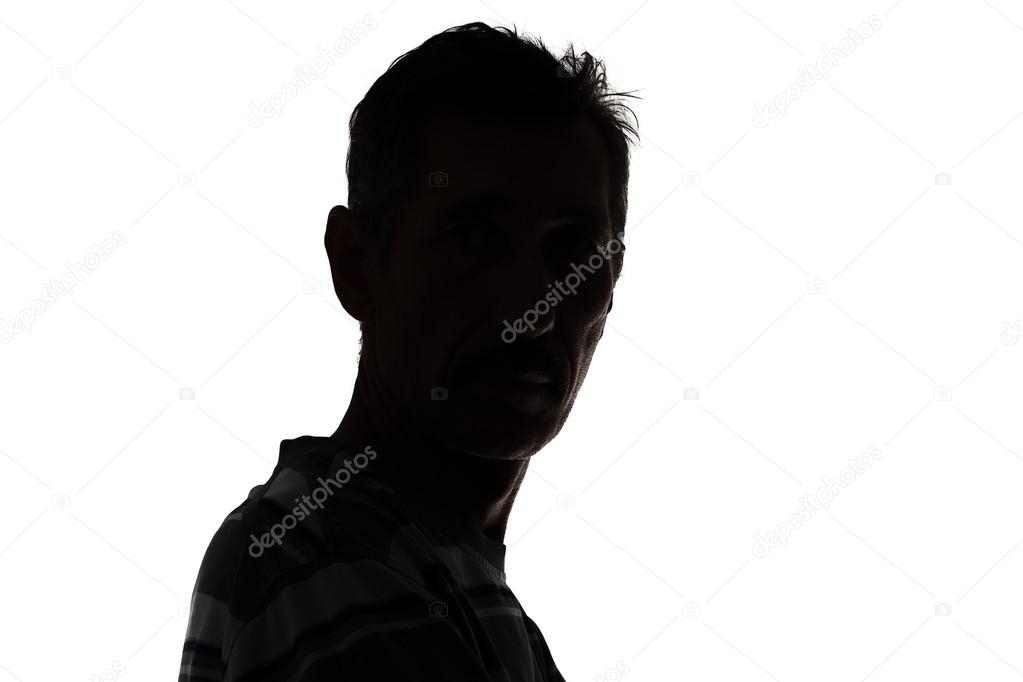 Silhouette of a man looking at camera