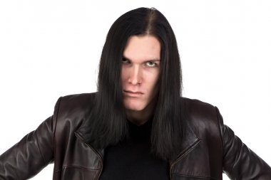 Portrait of angry informal man with long hair