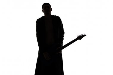 Photo of young mans silhouette with the guitar