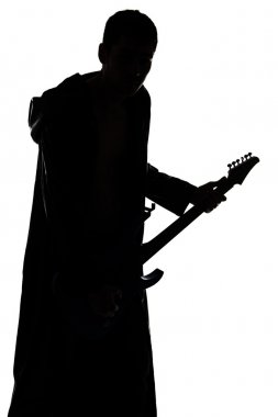Photo of young mans silhouette playing the guitar