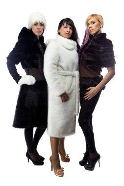 Three women in fur coats, full length