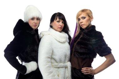 Photo of three women in fur coats