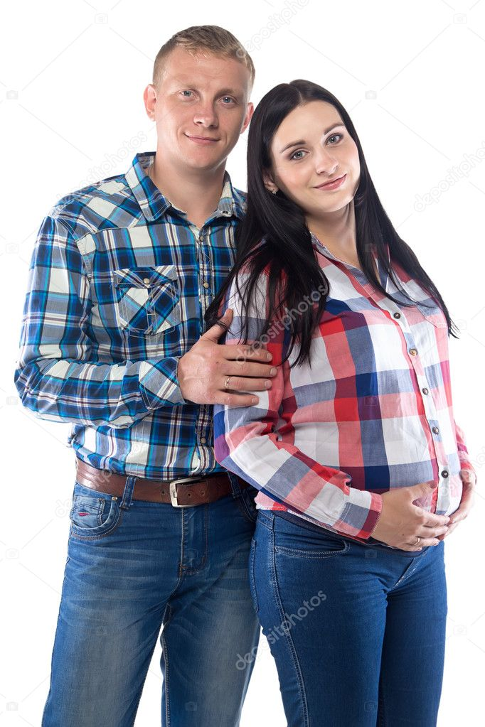 08d6e4843a024 Foto de hombre y mujer embarazada en las camisas de cuadros — Fotos de Stock
