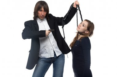 Man with pistol holding woman