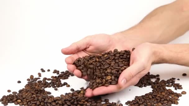 Scattering cofee beans in hands