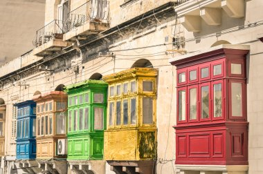 Vintage view of typical buildings balconies in La Valletta  - Colorful travel in Malta on the road - Popped up filtered version