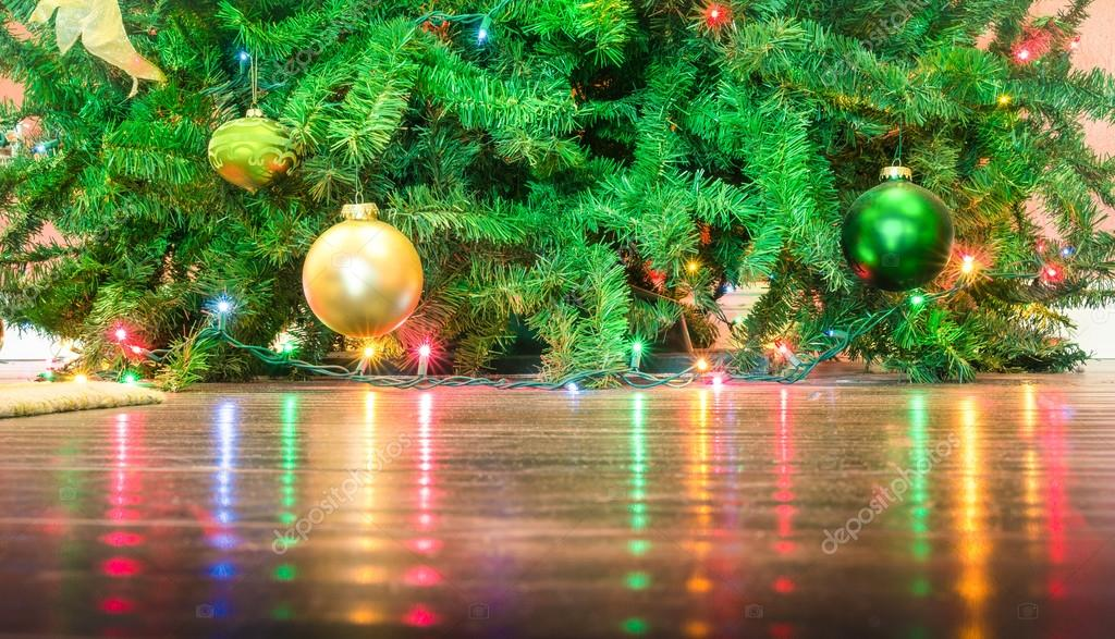 Detail of Christmas tree decorations with lights reflections on the floor - Cropped composition for holidays background– stock image