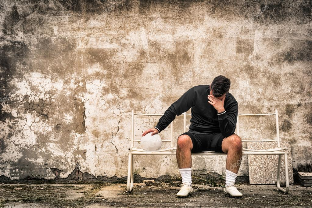 SocceSoccer football goalkeeper feeling desperate after sport failure - Concept of guilt related to negative doping experiencer football goalkeeper feeling desperate after sport failure
