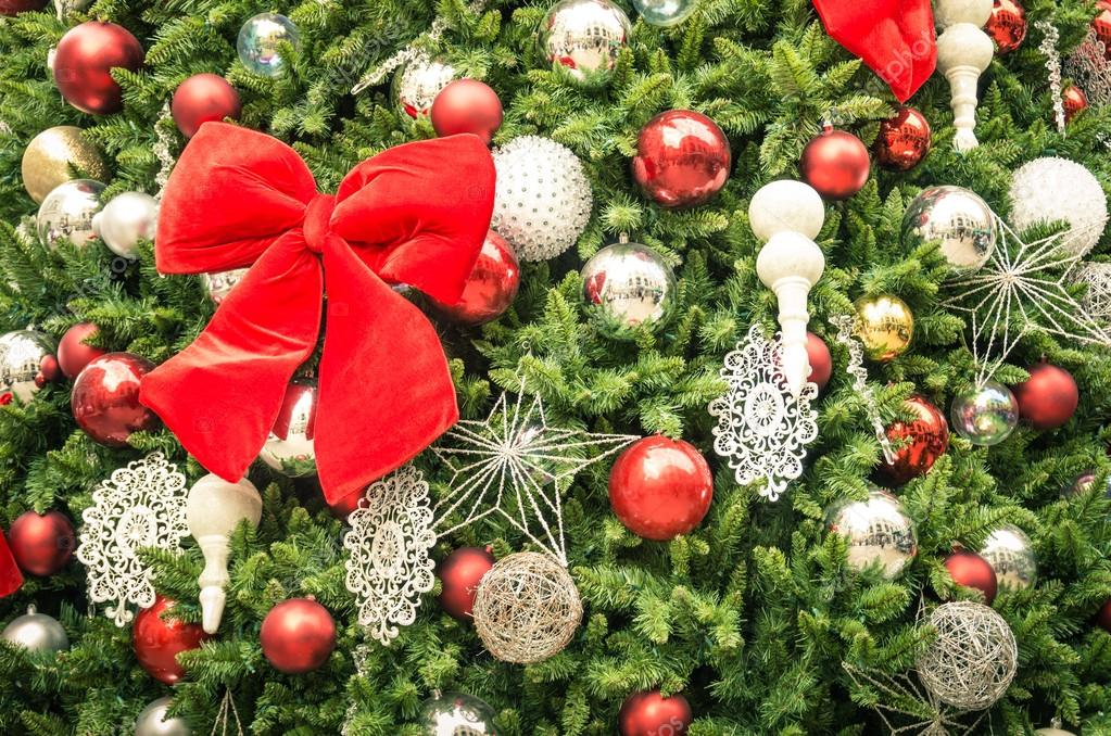Detail of Christmas tree decorations with red ribbon - Cropped composition for holidays background