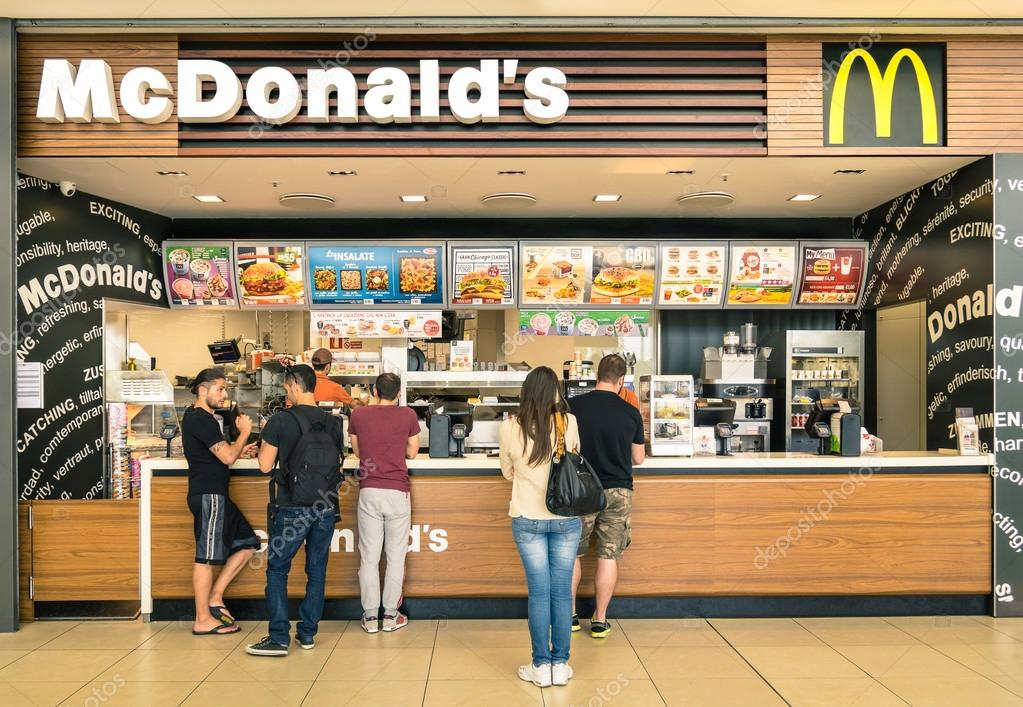 RIMINI, ITALY - MAY 30, 2014: people waiting for the food service at Mc Donalds desk in the shopping mall