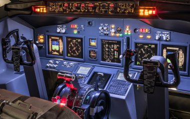 Lateral view of cockpit in homemade flight simulator - Concept of aerospace industry development - Flying simulation school for aviation learning pilots - All lights on ready for takeoff experience