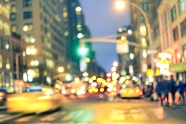 New york City abstract rush hour - Defocused yellow taxi cabs and traffic jam on 5th avenue in Manhattan downtown at blue hour - Blurred bokeh postcard on a retro vintage nostalgic filtered look