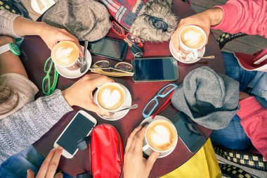 Group of friends drinking cappuccino at coffee bar restaurants - People hands with smartphones with upper point of view - Technology concept with addicted men and women - Soft vintage filter